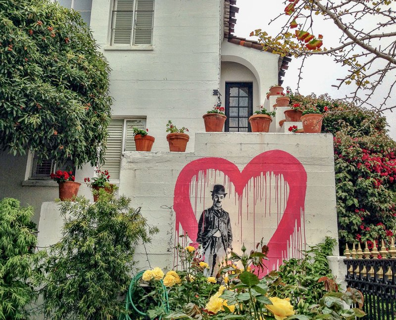 Charlie Chaplin graces the wall of the courtyard at the historic Cypress Inn built in 1928. Photo Credit: Wendy Nordvik-Carr©