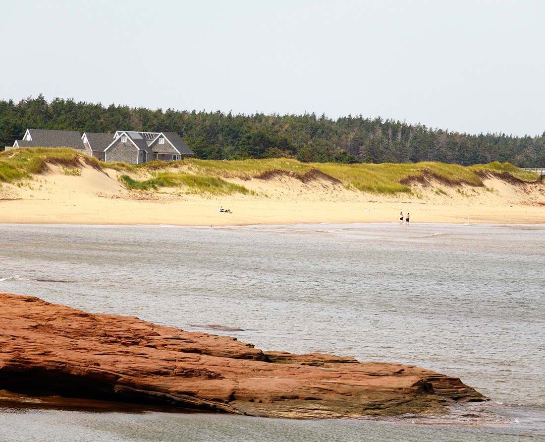 The scenic PEI Green Gable Shore drive gives you access to stunning Cavendish seascape views of red sandstone cliffs and pristine white sandy beaches. Photo Credit: Wendy Nordvik-Carr